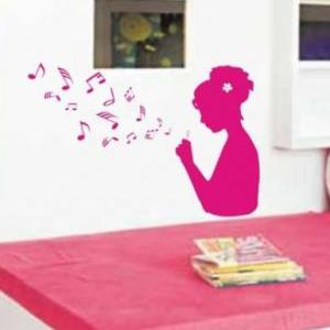 Girl Blowing Music Notes Wall Mural..